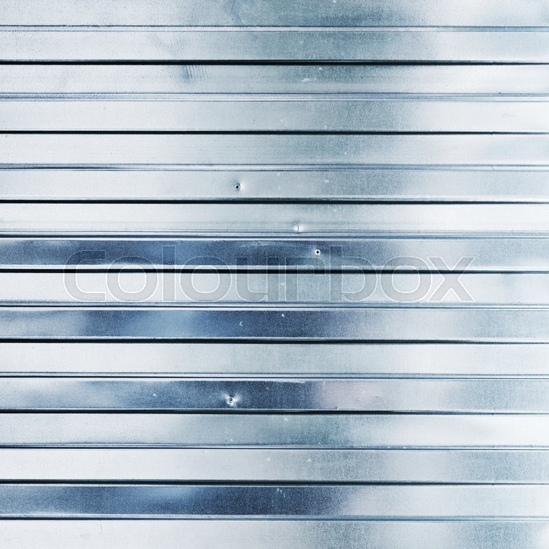 Stock image of 'New shining corrugated metal fence, industrial wall, square background photo texture'