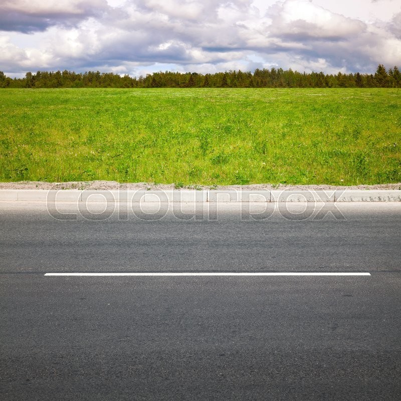Stock image of 'Empty highway roadside with green summer grass and forest on a background'
