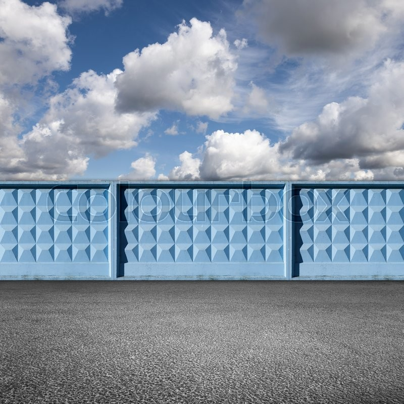 Stock image of 'Empty urban photo background, asphalt road and blue concrete fence under cloudy sky'