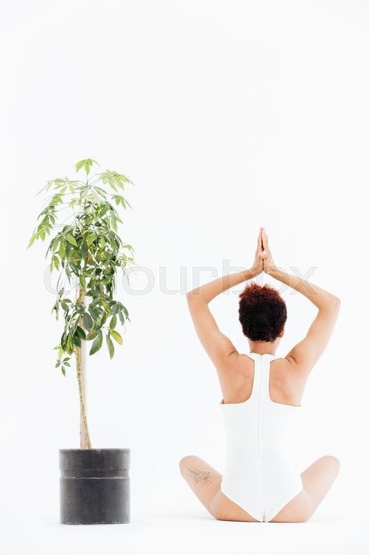 Stock image of 'Back view of african american woman in traditional yoga pose'