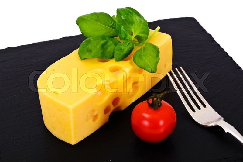 Stock image of 'Swiss Cheese on Black Background Studio Photo'