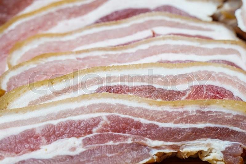 Stock image of 'Raw Bacon, pork belly, ready for cooking and frying'