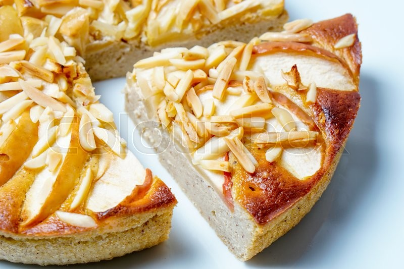 Stock image of 'Apple pie with almonds served on a white plate'