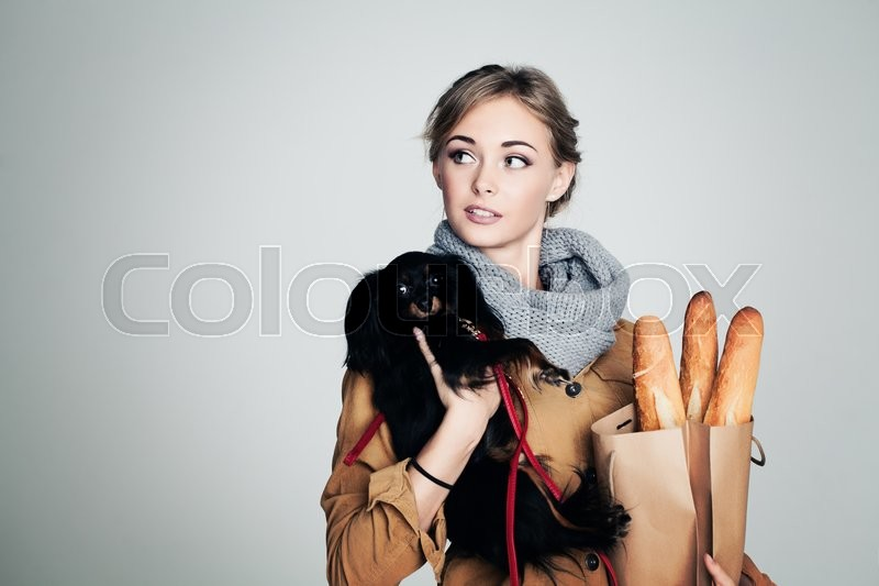 Stock image of 'French Woman with Small Dog and Baguette on Background with Copy Cpace'