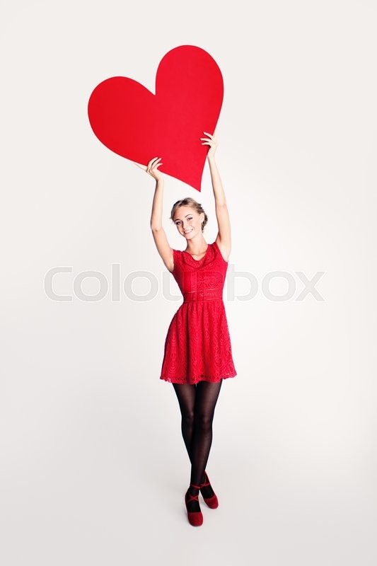 Stock image of 'Fashion Model holding Big Red Heart Banner'