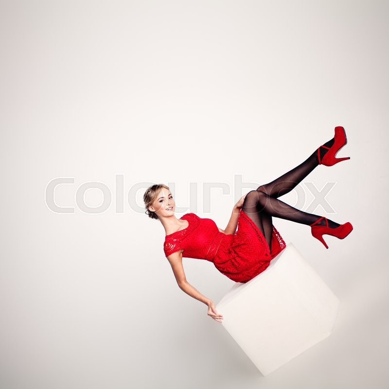 Stock image of 'Beautiful Woman Fashion Model in Red Dress'