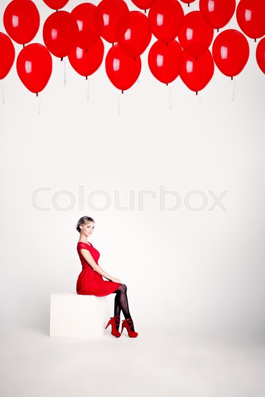 Stock image of 'Cute Woman on White Background with Red Balloons'