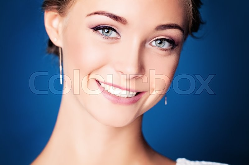 Stock image of 'Young Smiling Woman. Cute Face Closeup'