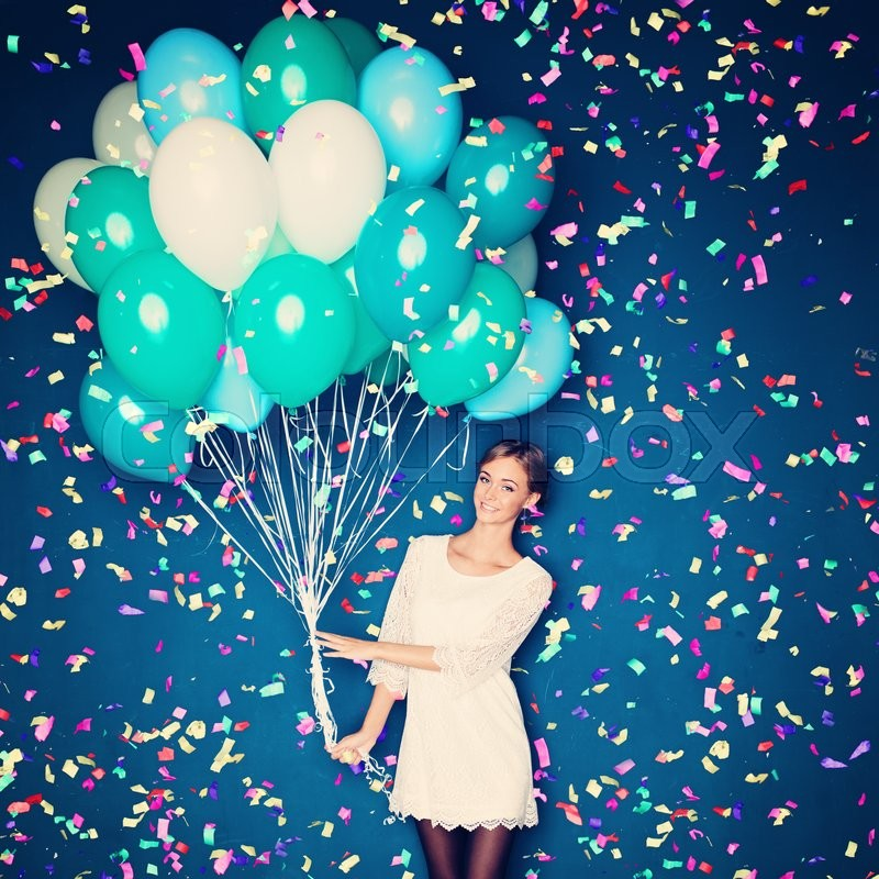 Stock image of 'Cheerful Woman with  Balloons and Confetti on Blue Background'