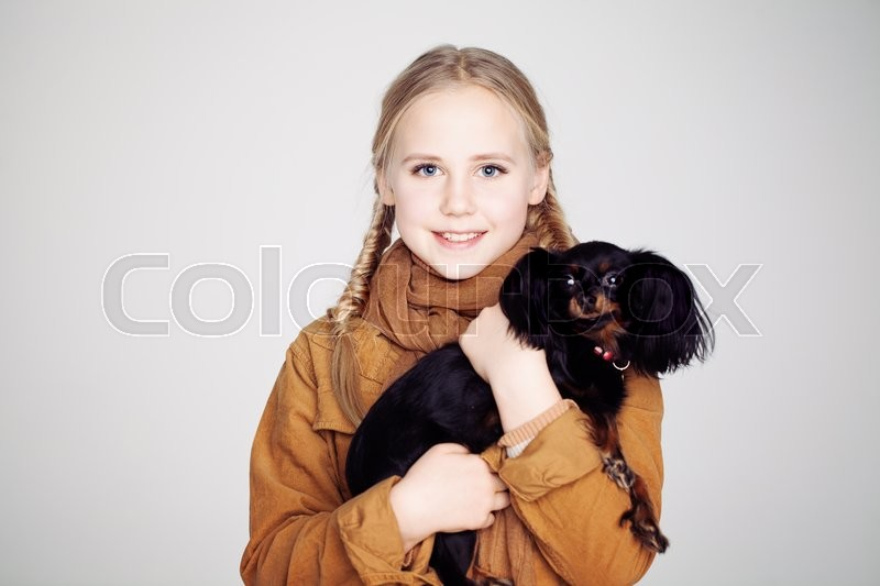 Stock image of 'Cute Child Girl with Puppy'