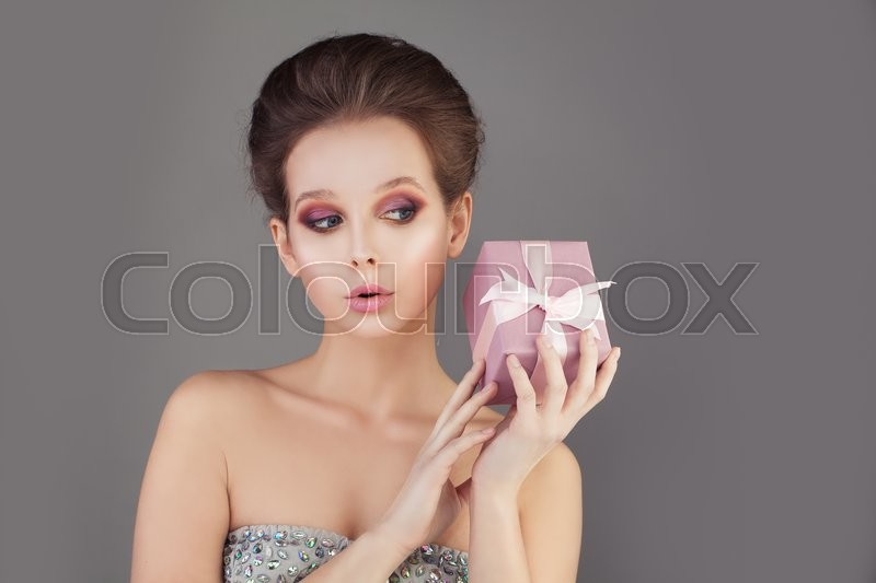Stock image of 'Lovely Fashion Model Woman holding Gift Box'