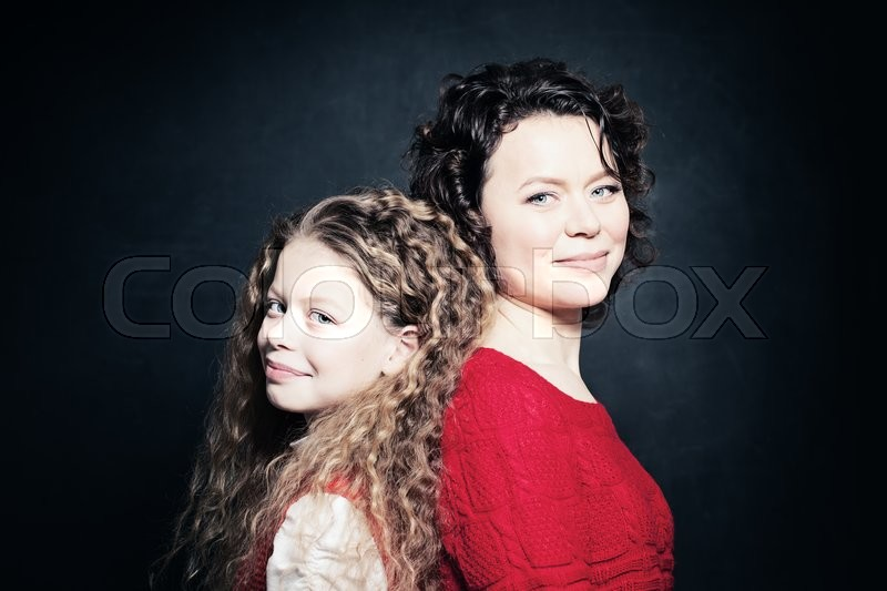 Stock image of 'Daughter and Mother Smiling. Happy Woman and Child'