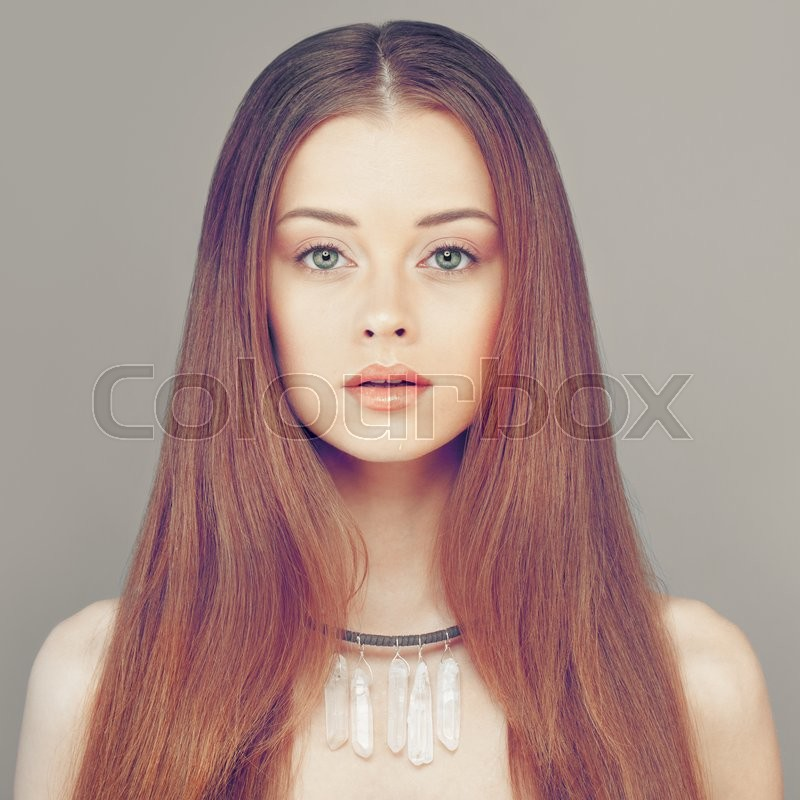 Stock image of 'Redhead Woman Fashion Model. Young Face and Red Hairstyle'