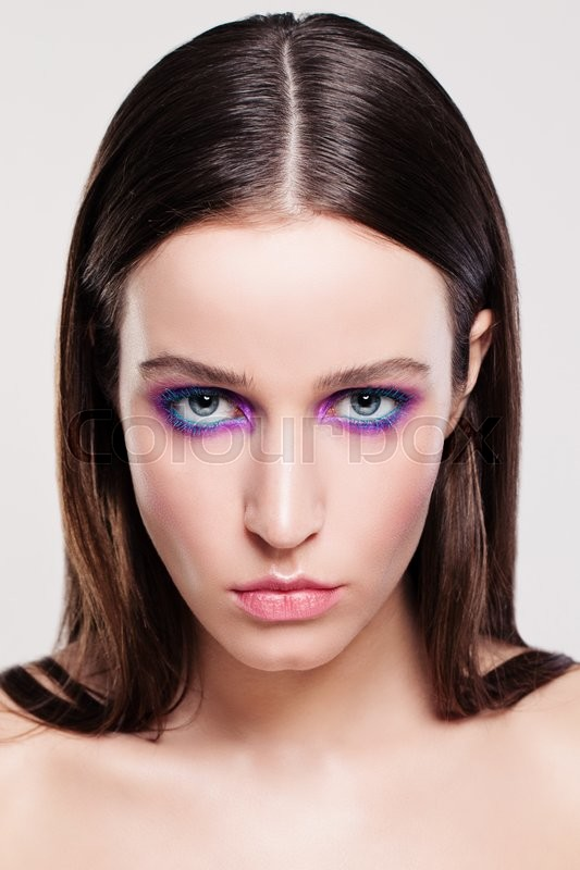 Stock image of 'Young Woman Face. Makeup and Brown Hair'
