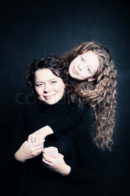 Stock image of 'Mother and Daughter. Parental Love and Care'