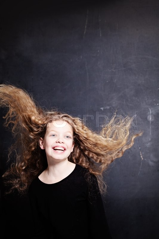 Stock image of 'Child Girl Jumping. Portrait on Dark Background with Copy Space'
