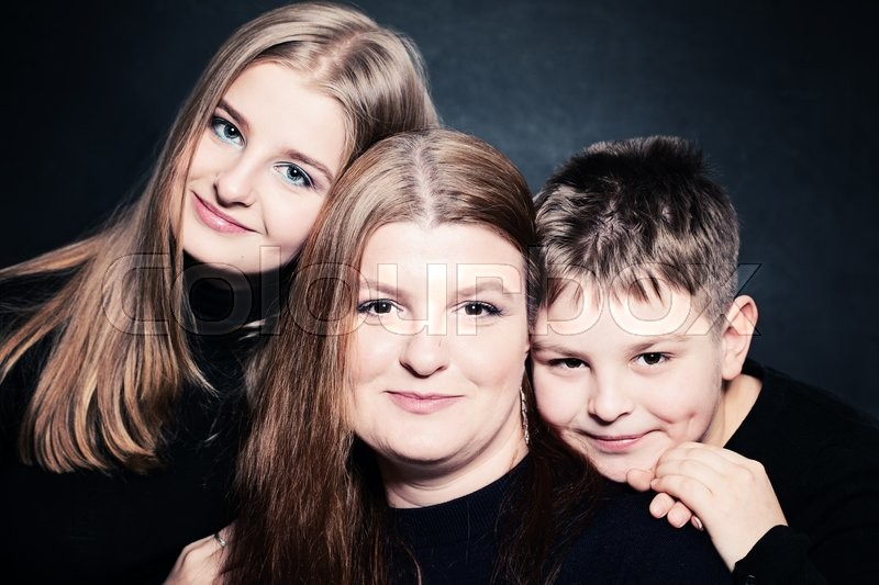 Stock image of 'Happy Family. Mother and Two Children'