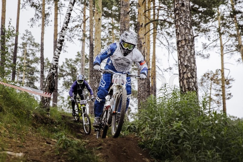 Editorial image of 'Miass, Russia - May 29, 2016: rivalry between two athletes mountain bikers on track during Cup \