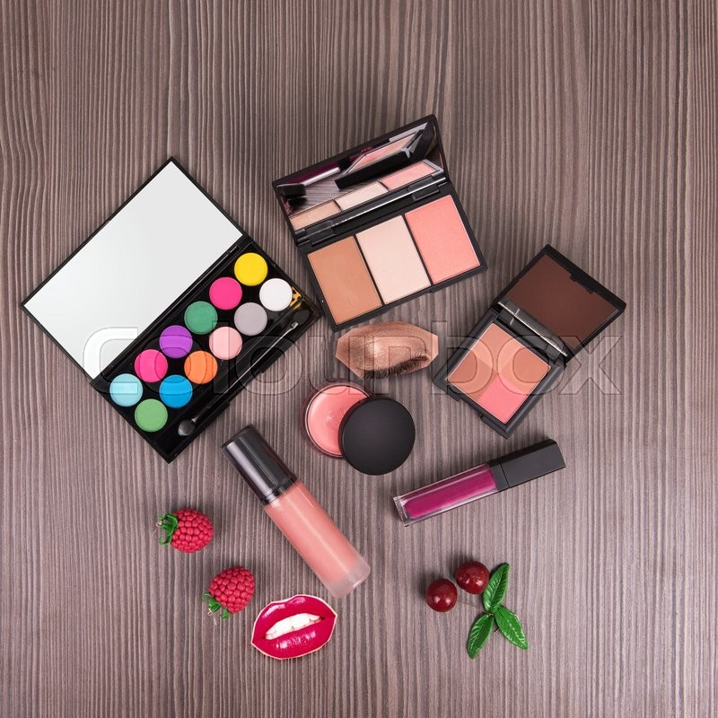 Stock image of 'summer cosmetics set for make-up on wood background'