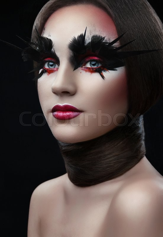 Stock image of 'girl with fashion red make-up and long eyelashes, the hair around the neck'