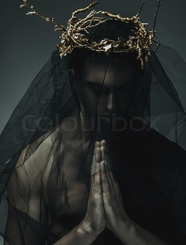 Stock image of 'Portrait of a masculine handsome man in elegant black cloth, with gold crown'