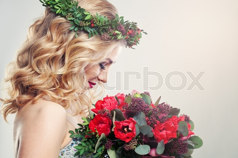 Stock image of 'Beautiful Woman with Tulip Flowers'