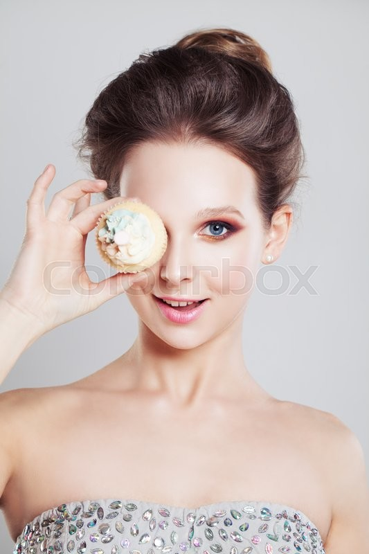 Stock image of 'Surprised Woman with Unhealthy Food'