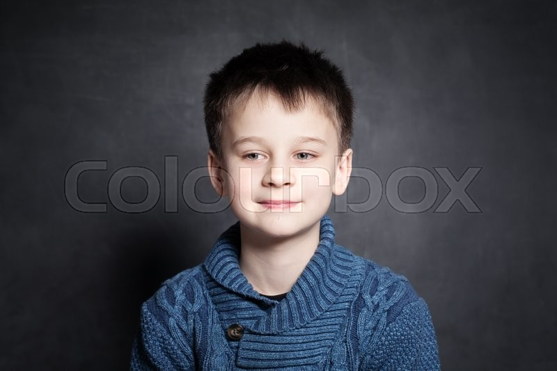 Stock image of 'Portrait of Child Boy on Dark Background'