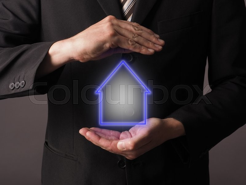Stock image of 'Business man with an insurance house concept'