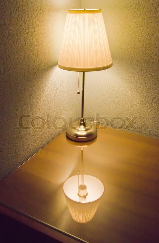Stock image of 'lamp on a table in the room'