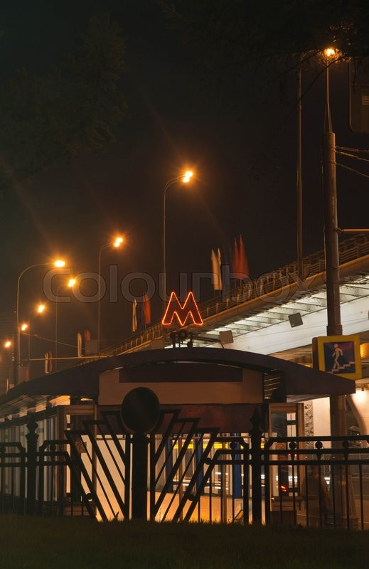 Stock image of 'subway entrance next to the road at night'