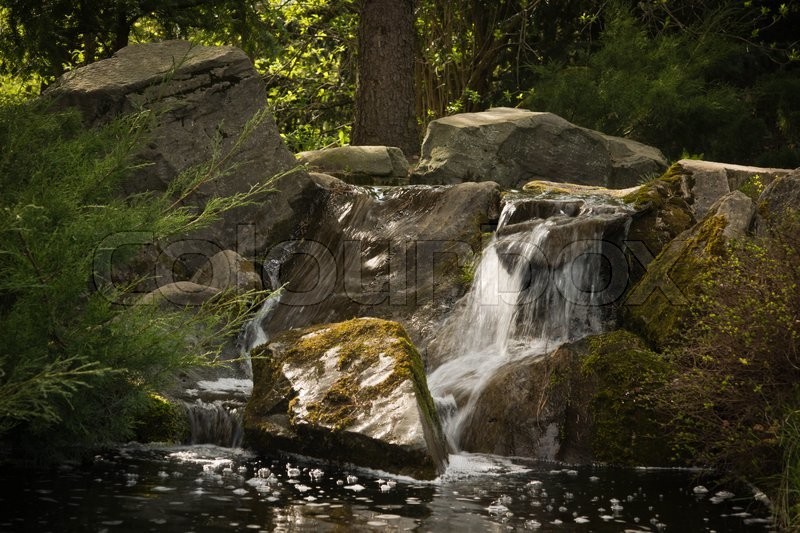 Stock image of 'waterfall in the forest at summer day'
