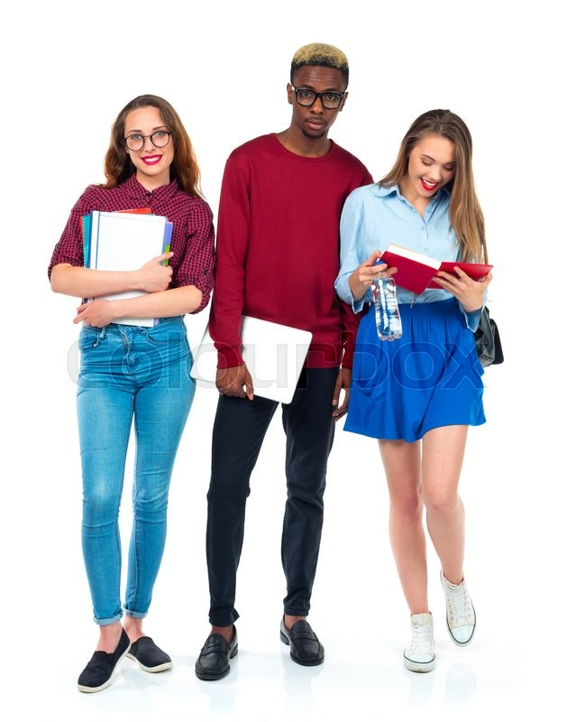 Stock image of 'Three happy young teenager students standing and smiling with books, laptop and bags isolated on white background'