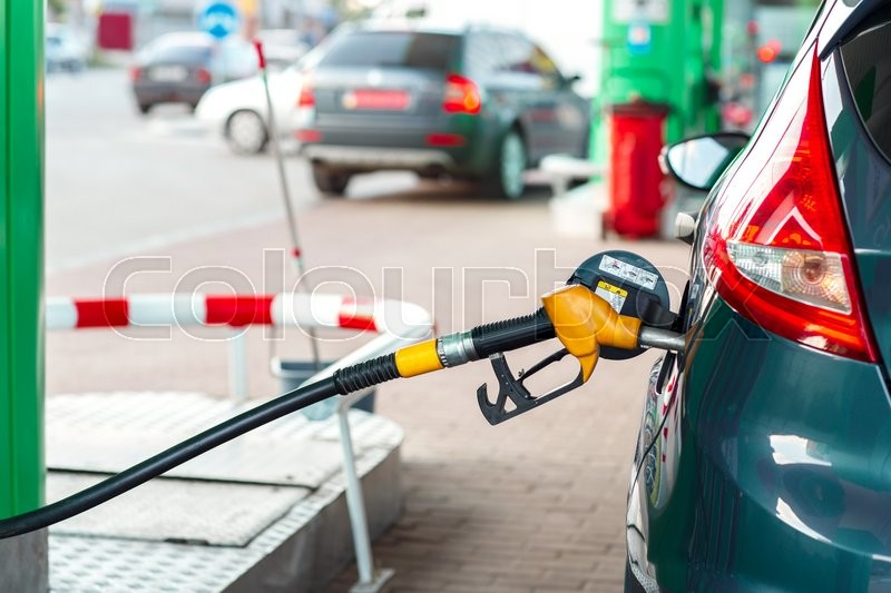 Stock image of 'Car refueling on a petrol station closeup'