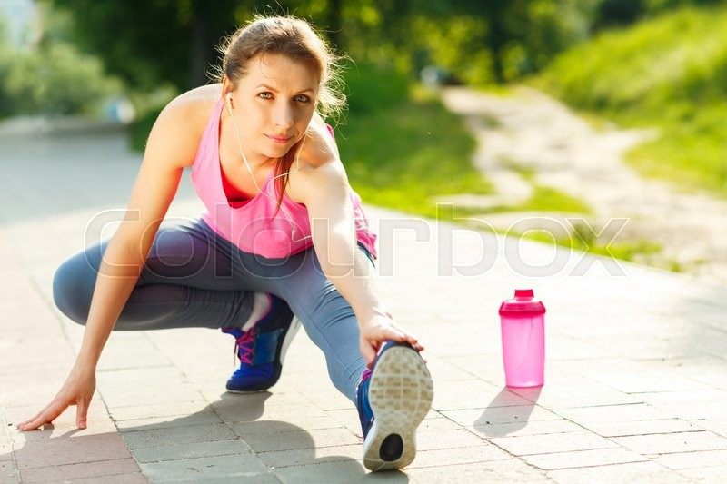 Stock image of 'Closeup shot of young woman warming up before running'
