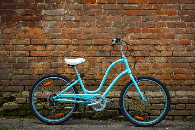 Stock image of 'Blue retro vintage bicycle with old brick wall'