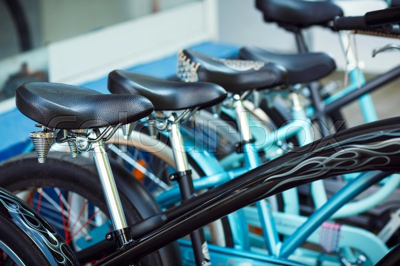Stock image of 'Close up of saddles of a group of bicycles on parking'