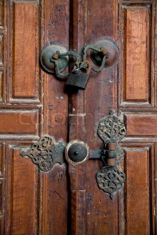 Marvelous Old Brown Wooden Door With Old Door Handle Closed Under Door Handles Collection Dhjemzonderlifede