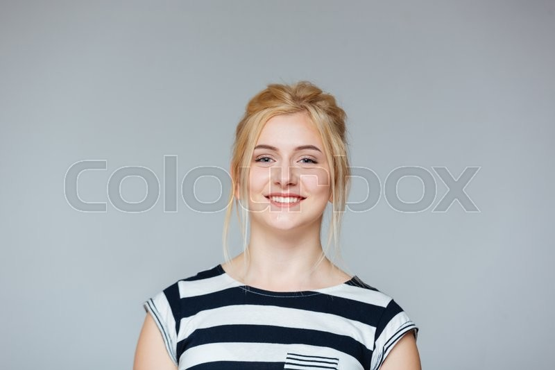 Stock image of 'Portrait of cheeful pretty young woman in striped t-shirt'