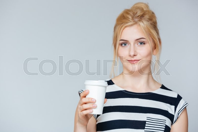 Stock image of 'Beautiful young woman drinking coffee to go'