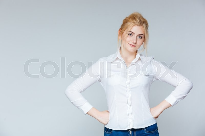 Stock image of 'Portrait of beautiful confident young woman in white shirt'
