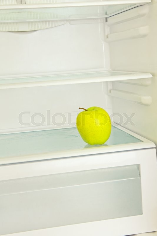 Stock image of 'Yellow apple in domestic refrigerator.Lifestyle concept.'