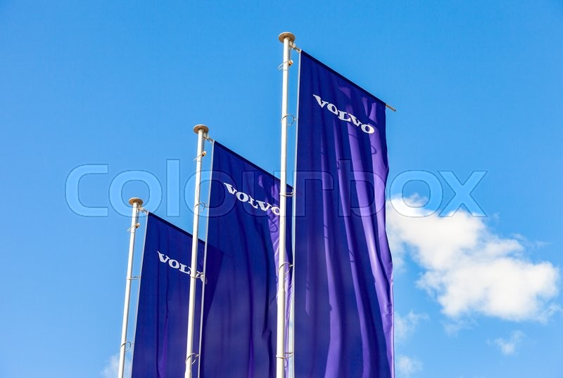 Editorial image of 'ST.PETERSBURG, RUSSIA - AUGUST 5, 2015: Volvo dealership flags over blue sky. Volvo is a Swedish multinational automaker company '