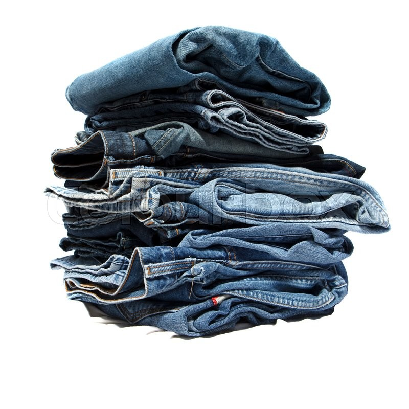 Stock image of 'Folded jeans stacked in a pile on white background'