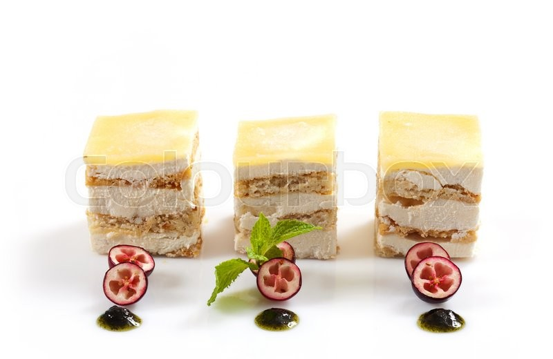 Stock image of 'three small dessert cakes isolated on white background'