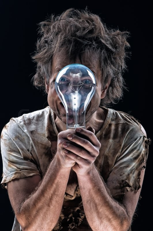 Stock image of 'Portrait of burnt man with light bulb over black background'