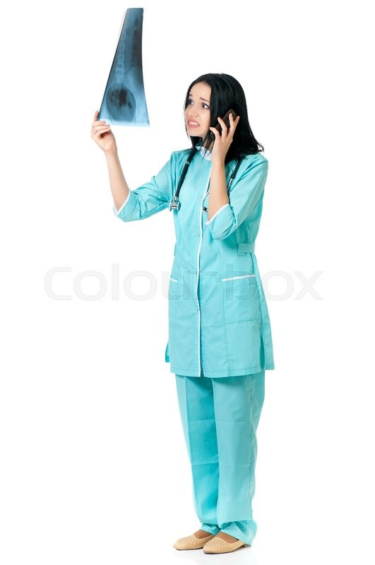 Stock image of 'Shocked female doctor examining a patient's x-ray, she  talking on phone'