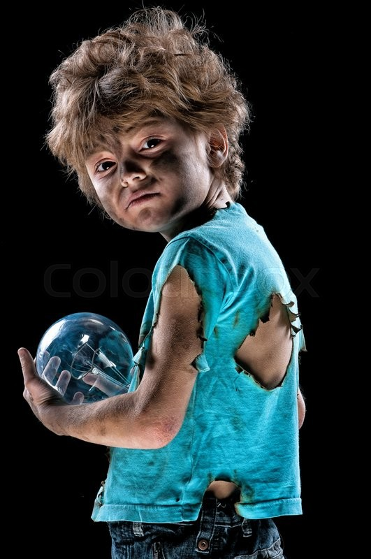 Stock image of 'Portrait of burnt little boy with light bulb over black background'