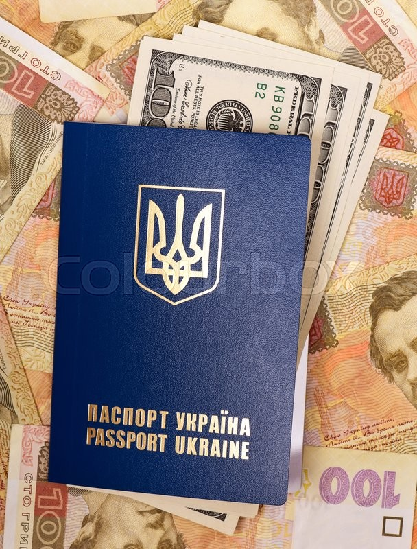 Stock image of 'International Ukrainian passport with US dollars on Hryvna banknotes background'