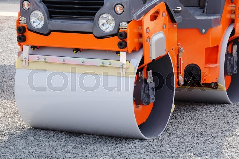 Stock image of 'The image of a road rollers under the white background'